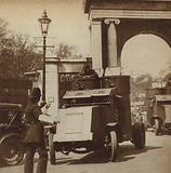 Armoured cars escorting a convoy of lorries carrying food from London's docks to Hyde Park during the General Strike, …