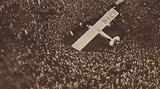 Crowds surrounding Spirit of St Louis, the aircraft in which American aviator Charles Lindbergh made the first successful solo transatlantic flight, at Croydon Aerodrome, 1927