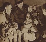 Gas masks being distributed to civilians as the threat of war with Germany over the Sudetenland crisis loomed, …
