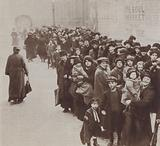 British housewives and their children queuing for their food rations, World War I, 1918