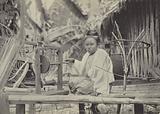 Burma: A Burmese country girl at her spinning wheel