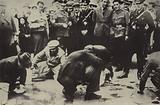 Jews forced by the Nazis to scrub the streets of Vienna, Austria, 1938