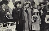 British suffragettes Emmeline and Christabel Pankhurst surrounded by supporters, 1908