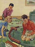 Children playing with a model railway