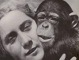 Young woman with young chimpanzee