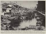 The contrasts of Canton, European comfort and Chinese squalor divided by a much congested creek