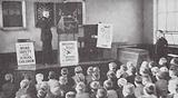 Policeman teaching road safety in a British school