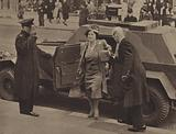 Queen Elizabeth and the armoured car she travelled in during bombing raids, World War Two