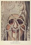 Actress Suzy Beryl in costume for a role at the Folies Bergere, Paris