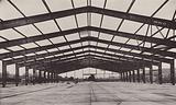 A 120 ft span two-pin arc-welded portal frame for a new factory
