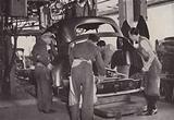 Loading car body components on to a special bogie-type assembly fixture in preparation for gun welding