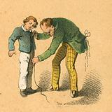 Boy being measured by his tailor