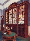 Inlaid Mahogany Break-Front Bookcase. Mahogany Pedestal Centre Table. Mahogany High-Case Clock.