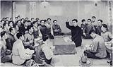 Comrade Kim Il-sung speaks at a meeting in Minyuvgow