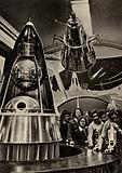 Group of tourists looking at a replica of the Soviet Sputnik satellite in the Exhibition of Achievements of the National Economy in Moscow, USSR, 1960s