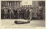 An entertainer escapes from a bound sack in Charing Cross Road, London