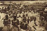 Africans praying with missionaries