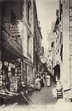 Postcard depicting a street in Mont Saint-Michel