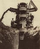 Soviet workers using heavy machinery to dig a ditch for an oil pipeline, USSR, 1931