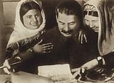 Soviet leader Joseph Stalin talking with Stakhanovite Kolkhoz workers from the cotton fields, 1934