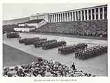 Nazi workers marching past the grandstand, Nuremberg Rally, 1936