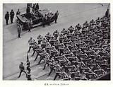 Members of the SA marching past Hitler, Nuremberg, 1936