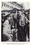 Joseph Goebbels meeting a badly wounded war veteran wearing the Blood Order, Nuremberg, 1936