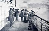 Spectators watching French aviator Charles de Lambert flying around the Eiffel Tower in a Wright Flyer biplane, Paris, …