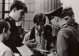 French youths talking with soldiers of the National People's Army at the Brandenburg Gate