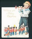 Boy playing with toy soldiers and blowing trumpet, Christmas Card