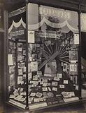 Window display of stationer, offering Christmas cards, calendars and prints