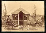 Woman in a donkey carriage with a gazebo