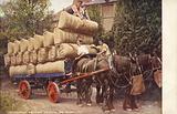 Farmers loading sacks onto a cart