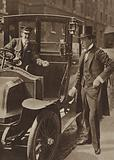 Winston Churchill paying a motor taxi fare, c 1908