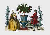 Man and woman in 18th Century dress in a garden
