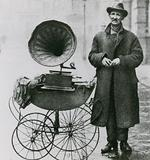 Untitled photograph of man with a phonograph in a pram