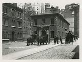 General view of horse-drawn carriages in Scotland Yard