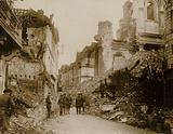 General Sir Samuel Hughes inspects the ruins brought about by German gunfire in the town of Arras