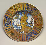 Large dish with segmental border of plant sprays and scale pattern