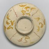 Shallow bowl on low foot with the muse Clio riding on a swan through a watery landscape