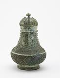 Lidded ritual wine container (hu) with masks and dragons