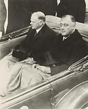 Franklin Delano Roosevelt and Herbert Hoover in convertible automobile on way to US Capitol for Roosevelt's …