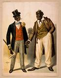 Two performers in blackface, facing each other, one in tuxedo, other in suit