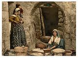 Syrian peasant making bread, Holy Land