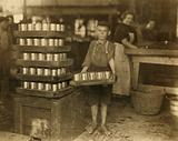 One of the small boys in J S Farrand Packing Co and a heavy load
