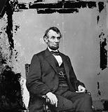 Abraham Lincoln, President of the United States, three-quarter length portrait, seated, facing right