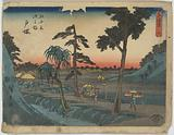 Totsuka. Print shows porters carrying a sedan chair and one carrying a shoulder pole with bundles on the Tōkaidō Road
