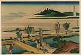 Sōshū nakahara. Print shows porters carrying bundles from a boat or warehouse (with thatched roof) at the end of a …