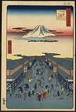 Suruga-chō. Print shows perspective view looking down commercial street with many pedestrians and porters, also shows …