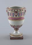 Urn with Female Heads on Pedestal